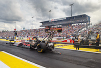 Mar 18, 2016; Gainesville, FL, USA; NHRA top fuel driver Steve Torrence (near) races alongside Doug Kalitta during qualifying for the Gatornationals at Auto Plus Raceway at Gainesville. Mandatory Credit: Mark J. Rebilas-USA TODAY Sports