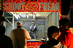 """Shoot the Freak"" booth at the San Gennaro Festival, NYC, 9/14/04"