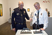 Santa Monica Police Chief Timothy J. Jackman and Santa Monica Fire Chief Scott Ferguson discuss David Kuntz's sculpture at Track 16 Gallery during  City of Santa Monica's  20th annual Boards and Commissions meeting on Monday, May 2, 2011.