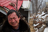 A 50-year-old farmer weeps in front of his ancestral home destroyed by the Chinese government to make way for modern high-rise in central China.<br /> <br /> Communist leaders are pushing ahead with a gigantic, historic plan to uproot 100 million farmers and turn their fields into urban dwellings by year 2020 to create a giant new middle class and boost demand.