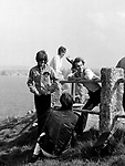Beatles 1967 George Harrison and John Lennon with Neil Aspinall film Magical Mystery Tour at Newquay ..© Chris Walter..