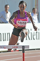Sheena Tosta of the United States on her way to win the Women's 400m Hurdles race at the 2010 IAAF World Challenge on August 29, 2010  in Rieti (Italy).