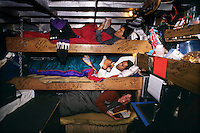 The F/V Little Comfort from top to bottom: Kevin Imai, ken Larson and Karen Ducey sleep in their bunks, or racks, during the Bristol bay sockeye salmon fishery in July 1994.  Bristol Bay is home to the world's largest sockeye salmon fishery.  The commercial salmon drift gillnet fishing fleet is limited to boats no longer than 32 feet in length.  There were over 1,800 permanent entry permits listed in 2002 which each vessel is required to have.  Typically boats fish with two or three deckhands.  Peak of the season is around July 4th in this fishery which lasts about a month. The rivers also get a fair amount of chum, king, and chinook salmon. Bristol Bay is located in the southwest part of Alaska. This fishery is managed by &quot;the Alaska Department of Fish and Game&quot; and is a sustainable fishery.  Until around the year 2000, fishing on the Egegik North Line was lively and lucrative..