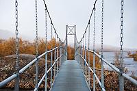 Hanging footbridge over river to Abiskojaure hut, Kungsleden trail, Lapland, Sweden