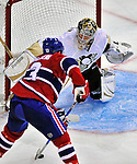 21 September 2009: Pittsburgh Penguins' goaltender John Curry keeps his eye on an approaching Mike Cammalleri in the third period of a pre-season game against the Montreal Canadiens at the Bell Centre in Montreal, Quebec, Canada. The Canadiens edged out the defending Stanley Cup Champions 4-3. Mandatory Credit: Ed Wolfstein Photo