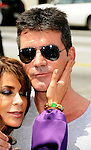 Paula Abdul and Simon Cowell 2011 at the first Judged auditions for X Factor at Galen Center in Los Angeles, May 8th 2011...Photo by Chris Walter/Photofeatures