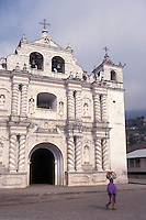 Maya woman walking by the church in the village of Zunil near Quetzaltenango, Guatemala