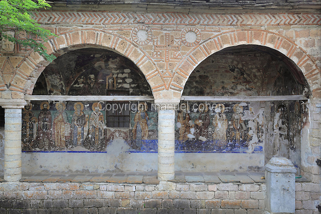 Arcaded portico of the Church of St Nicholas or Kisha e Shen Kollit, built 1721, with frescoes painted 1726 by David from Selenitsa and the Apocalypse series in the arcade or hayat painted in 1750 by brothers Constantine and Athanas from Korce, nicknamed ìZographyî, Voskopoje, Korce, Albania. Picture by Manuel Cohen