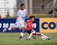 Jose Villavicencio (5) of El Salvador has the ball tackled away from him by William Quiros (20) of Costa Rica during the group stage of the CONCACAF Men's Under 17 Championship at Jarrett Park in Montego Bay, Jamaica. Costa Rica defeated El Salvador, 3-2.