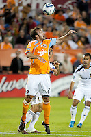 Eddie Robinson of the Houston Dynamo and Landon Donovan of the Los Angeles Galaxy look for the header during the regular season game between the Los Angeles Galaxy and the Houston Dynamo at Robertson Stadium in Houston, TX on April 10, 2010. Los Angeles 2, Houston 0.