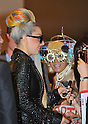 """May 8, 2012, Narita, Japan - Lady Gaga, sporting a leather coat and her rainbow-colored hair, is greeted by Japanese fans upon her arrival at Narita Airport, east of Tokyo, on Tuesday, May 8, 2012. ..The American pop singer and song writer was in Japan on a """"Lady Gaga/The Born This Way Ball"""" world tour. It was her sixth visit to Japan where a teacup and saucer, marked with her lipstick and bearing the Japanese message We pray for Japan along with the stars autograph, has fetched more than $75,000 at auction.(Photo by Natsuki Sakai/AFLO) AYF -mis-.."""