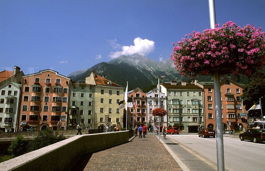 Colorful houses with flowers and bridge in Old Town on the Inn River in Innsbruck Austria