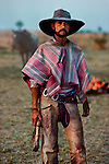 00061_12, Chaco, Paraguay, 1988, PARAGUAY-10003ns. A Gaucho stands with pride.<br />