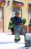 13 September 2001: NYC fireman takes off his coat and walks away from the smoldering building after the Terrorist attack on the America's.  Lower Manhattan, NY. Area surrounding ground zero where the World Trade Centers WTC once stood only hours after they fell to the ground in New York.  Islamic terrorist Osama bin Laden declares The Jihad or Holy War against The United States of America on September 11, 2001. Headline news photos available for editorial use.