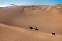 Off-road vehicles in sand dunes, Namib-Naukluft National Park, Namibia
