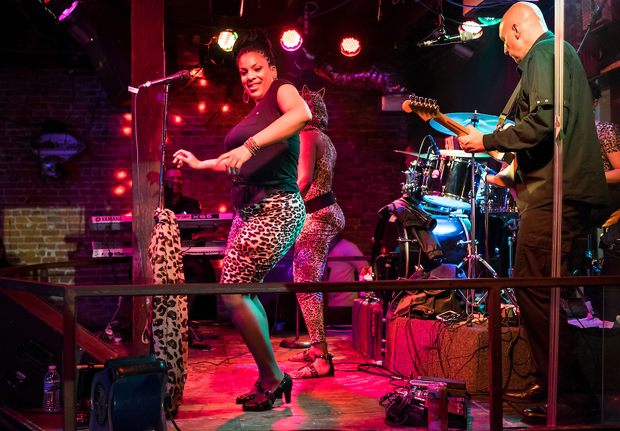 NEW ORLEANS - CIRCA FEBRUARY 2014: African American singer performing and dancing in a nightclub during the Mardi Gras celebration in the French Quarter in New Orleans
