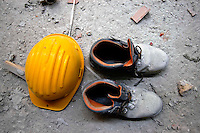 May 2008.Helmet and shoes of a worker on a construction site in Rome   .Elmetto e scarpe  di un lavoratore edile in un cantiere di Roma