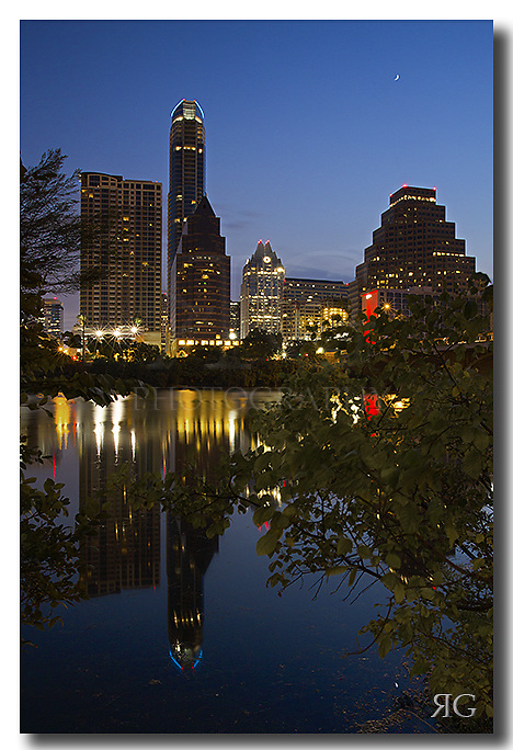 The Austonian, Austin's tallest building, rises into the early morning hours of a September sunrise. This Austin image was taken about 45 minutes before the sun rose over the horizon. Ladybird Lake was quiet and the waters were calm. <br /> <br /> I like mornings like this, and I enjoy experiencing the city coming to life as folks get out and exercise, or just take a nice stroll on a peaceful morning in the shadow of the Austin skyline.
