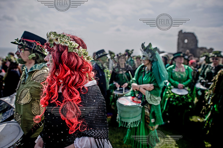 People gather for a Jack in the Green festival. The festival is part of a recent revival of an older custom where people would wear frameworks covering much of their bodies which were decked out in foliage. The custom is connected to English May Day parades that herald  the coming of summer.