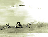 A-1H Skyraiders make a low-level pass over Vietnamese tanks and ground troops during a training exercise somewhere in South Vietnam on Nov. 21, 1963.  .
