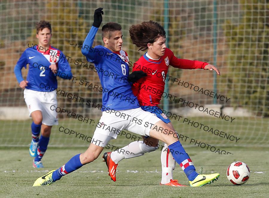 Fudbal  Reprezentacija Srbije<br /> Prijateljski mec Friendly match<br /> Srbija U17 v Croatia U17 <br /> Luka Jovic (R) and Tin Kulenovic<br /> Beograd, 11.12.2013.<br /> foto: Srdjan Stevanovic/Starsportphoto &copy;