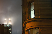 New York, NY -  6 December 2011 The Empire State Building and the Fuller Building (Flatiron Building) on a foggy December night.