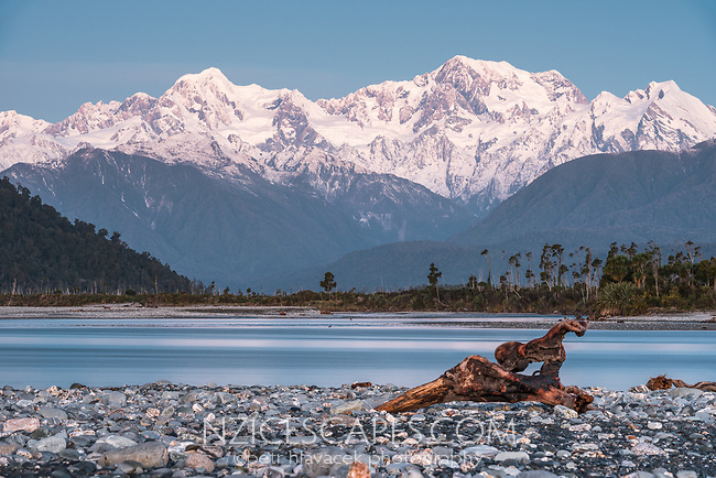 Blue light of twilight over Southern Alps, Mount Tasman and Aoraki Mount Cook, driftwood and Cook River in foreground, Westland Tai Poutini National Park, UNESCO World Heritage Area, West Coast, New Zealand, NZ
