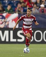 FC Dallas midfielder Daniel Cruz (7) brings the ball forward. In a Major League Soccer (MLS) match, the New England Revolution defeated FC Dallas, 2-0, at Gillette Stadium on September 10, 2011.