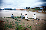 Men fish in the Dakbla River at dusk in the Central Highlands town of Kon Tum, Vietnam. April 13, 2012.