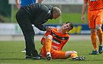 St Johnstone v Dundee Utd....21.04.12   SPL.Gavin Gunning injured.Picture by Graeme Hart..Copyright Perthshire Picture Agency.Tel: 01738 623350  Mobile: 07990 594431