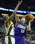 Sacramento Kings'  Mike Bibby, R, is fouled while going to the basket by Seattle SuperSonics'  Ray Allen in the second period of their first round playoff game at Key Arena in Seattle, Washington Saturday, 23 April  2005..Jim Bryant Photo. &copy;2010. All Rights Reserved.