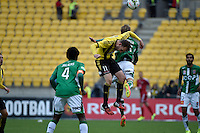 Jeremy Brockie and Jacob Pepper in action during the A League - Wellington Phoenix v Newcastle Jets Game at Westpac Stadium, Wellington, New Zealand on Sunday 26 October 2014. <br /> Photo by Masanori Udagawa. <br /> www.photowellington.photoshelter.com.