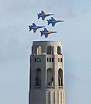 The Blue Angels roar over Coit Tower during a practice or survey flight in preparation for their air show this week-end during San Francisco annual visit of fleet week.
