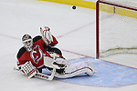 Mar 27; Newark, NJ, USA; Chicago Blackhawks center Andrew Shaw (65) hits the post behind New Jersey Devils goalie Martin Brodeur (30) during the overtime shootout at the Prudential Center. The Devils defeated the Blackhawks 2-1.