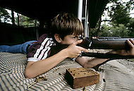 College-Station, Texas, U.S.A, June, 1981. Children are taught how to handle firearms at a special school created by the retired colonel Sid Loveless. Parents send their children for special shooting courses at a younger and younger age.
