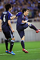 (R-L) Shinji Okazaki, Atsuto Uchida (JPN),.JUNE 3, 2012 - Football / Soccer :.Shinji Okazaki of Japan scores his team's third goal during the 2014 FIFA World Cup Asian Qualifiers Final round Group B match between Japan 3-0 Oman at Saitama Stadium 2002 in Saitama, Japan.  (Photo by Takahisa Hirano/AFLO)