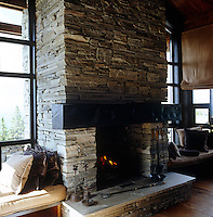 In this Norwegian house the local stone is used to stunning effect for the main fireplace