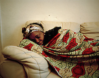 """32 year old Monique from DR Congo sleeps on a friend's sofa in North London whenever she can. She had completed three years of a four year course in electrical engineering at a university in Kinshasa when she decided to attend a student demonstration opposing the government. To her horror, she witnessed the murder of her friends by government forces who wanted to put an end to the demonstration. Until then she had led a comfortable life, her father was a doctor and her family placed a great deal of emphasis on education. Monique was later arrested, detained and tortured. Friends helped her flee the country after her release from prison, and she arrived in December 2002, claimed asylum and had her case rejected. In December 2007 her support was cut off and she became destitute. Some nights she has slept in a church in Tottenham, at other times with friends or in the park. """"I hate to sleep in the park because it's very dangerous,"""" she says. Nightmares about being forcibly returned to DR Congo plague her. """"If they send me back they might as well put me in a coffin-shaped suitcase."""" Monique is one of an estimated 300,000 rejected asylum seekers living in the UK. .."""