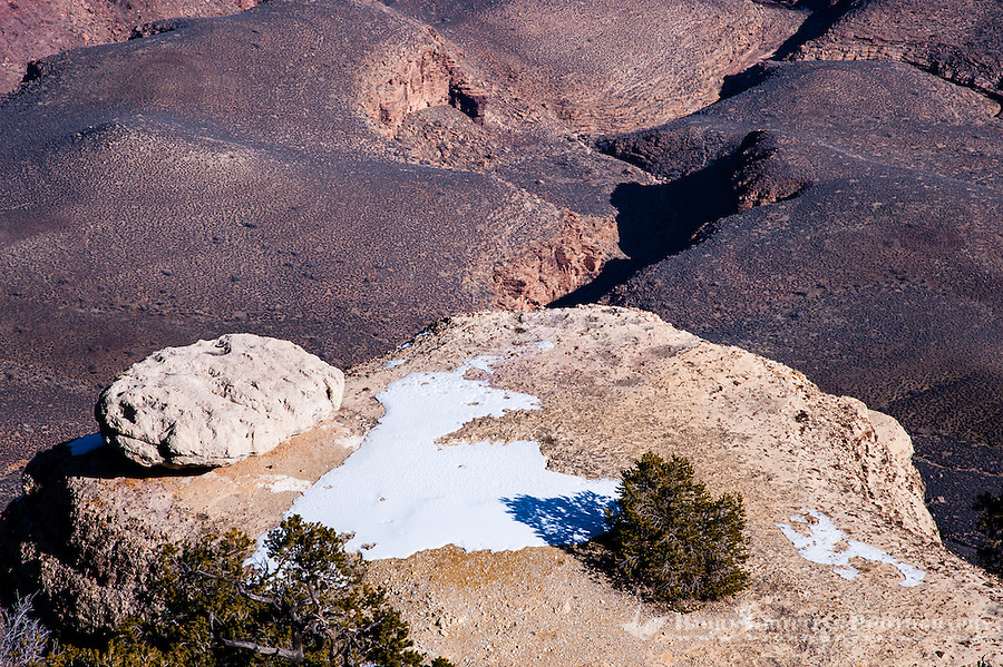 United States, Arizona, Grand Canyon. View from Yaki Point. Snow on a big rock.