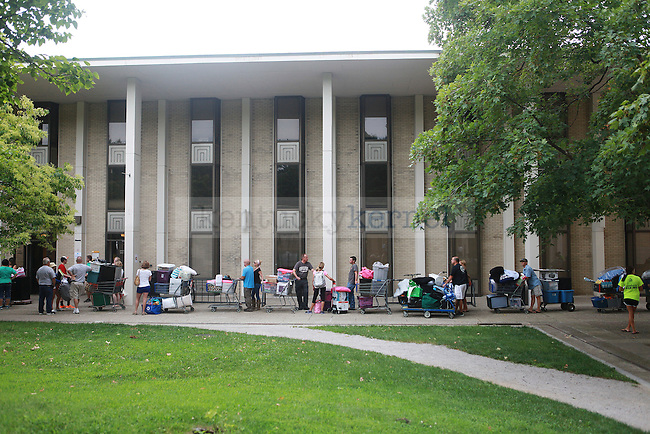Students wait in line to move in to south campus dorms in Lexington, Ky., on Friday, August 23, 2013. Photo by Emily Wuetcher | Staff