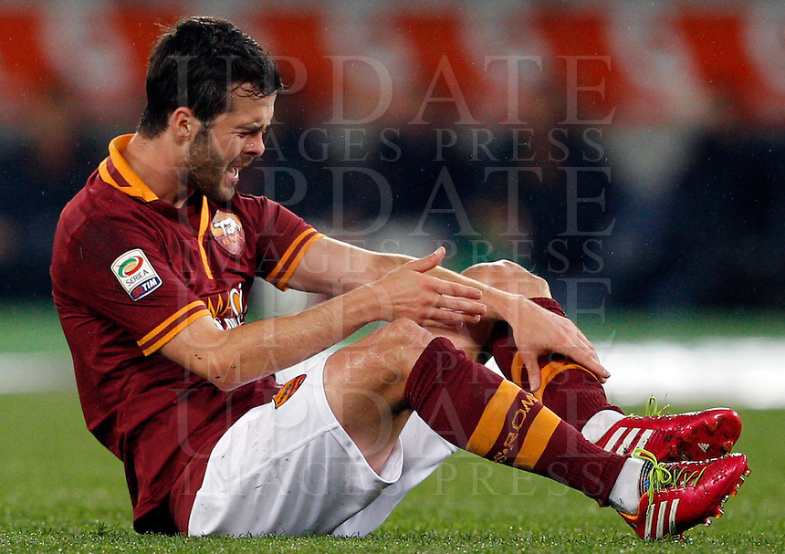 Calcio, Serie A: Roma vs Torino. Roma, stadio Olimpico, 25 marzo 2014.<br /> AS Roma midfielder Miralem Pjanic, of Bosnia, reacts after being injured during the Italian Serie A football match between AS Roma and Torino at Rome's Olympic stadium, 25 March 2014.<br /> UPDATE IMAGES PRESS/Riccardo De Luca