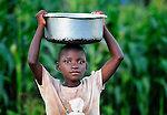 A girl carries a pan on her head in Karonga, a town in northern Malawi.