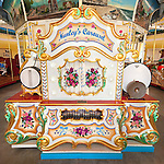 Nunley's Carousel Organ, Garden City, New York, USA, on June 28, 2012, SQUARE  [NOTE digital alterations: cable from carousel platform removed from lower corner; unlit bulbs changed to lighted]
