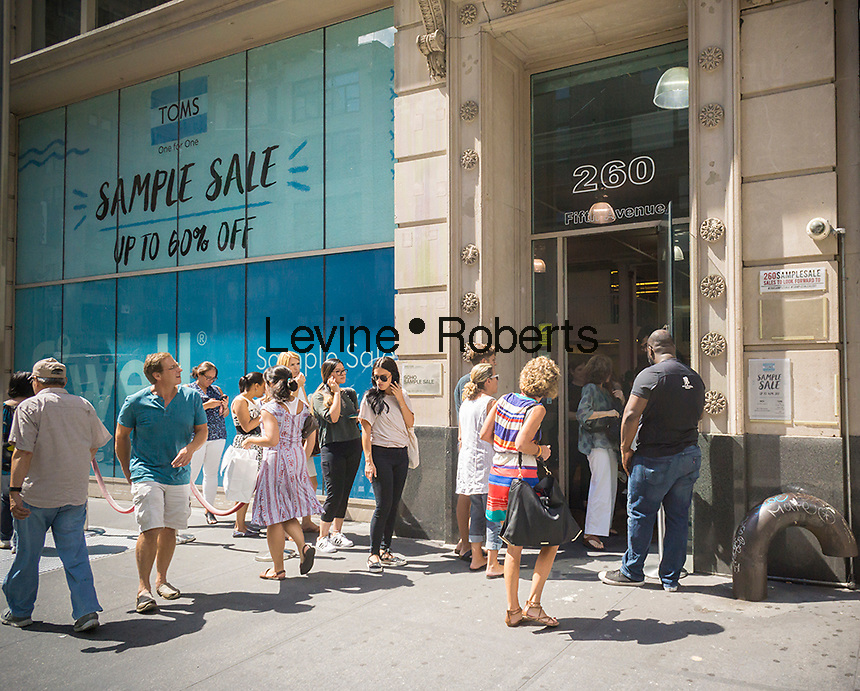 Fashion and budget conscious shoppers flock to combined Toms One for One and S'well sample sales in New York on Tuesday, August 30, 2016.  (© Richard B. Levine)