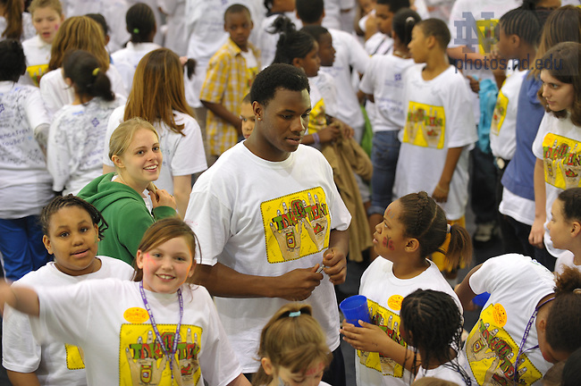 """Notre Dame Football player Darius Fleming helps with the Robinson Center's """"Take Ten"""" event at Stepan Center, April 2009...Photo by Matt Cashore/University of Notre Dame"""