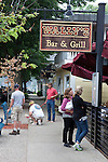 Patrons wait for dinner outside Wally's Bar and Grill, Saugatuck, Michigan, USA