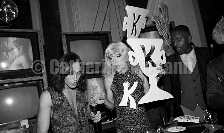 Oct 17 1990:  Drag queen Lahoma Van Zandt (R) and DJ Andy, in front of a bank of televisions at the Limelight nightclub in New York City, New York.