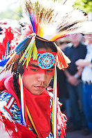 Kiowa-Navajo actor and model Malachi Tsoodle Nelson strikes a colorful pose during the July Santa Fe Indian Market's Native American costume competition, which attracts participants from many states across the nation