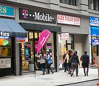 A T-Mobile USA store is seen in Lower Manhattan in New York on Wednesday, October 3, 2012. MetroPCS and T-Mobile USA announced that  Deutsche Telekom AG, the owner of T-Mobile USA will now hold a 74 percent stake in the merged companies with the remaining shares held by MetroPCS shareholders who will also get a $1.5 billion payment. The combined companies will have almost 42 million subscribers but will still only be the fourth largest US cell phone company. (© Richard B. Levine)