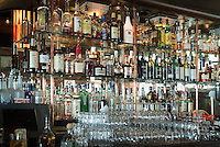 Irish Pub, San Francisco, CA, Fisherman's Wharf, District, Bar stacked with Wiskey Bottles, Glasses High dynamic range imaging (HDRI or HDR)